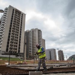 (150722) -- RIO DE JANEIRO, July 22, 2015 (Xinhua) -- A worker handles the steel bars on the construction site of the Olympic and Paralympic Village in Rio de Janeiro, Brazil, July 21, 2015. The Rio 2016 Olympic and Paralympic Village situates in the Barra da Tijuca area, southwest of the city Rio de Janeiro. The village is constructed next to the Barra Olympic Park, which will be the heart of Rio 2016 Games. The construction of the 475,000 squaremeters residential complex has 31 buildings, each with 17 floors, and divided into seven condominiums. The 3,604 apartments and 10,160 bedrooms will have a total capacity of 18,000 guests.      After construction work is completed, the process of transforming the buildings into the residential complex will begin. Temporary structures will include a health centre, a cafeteria with space for 5,000 diners and a gym. By now the village is 85 percent completed, and it is scheduled to be fully operational and opened to guests from 9 o'clock of July 24, 2016.(Xinhua/Xu Zijian)(wll)