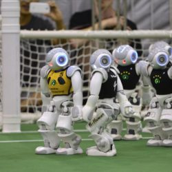 """Humanoid robots compete during the 2015 Robocup finals in Hefei, Anhui province, July 22, 2015. The Robocup, or """"Robot Soccer World Cup"""", is an annual international robotics competitions which is held between July 17 - 23 this year in China's Hefei.  REUTERS/Stringer  CHINA OUT. NO COMMERCIAL OR EDITORIAL SALES IN CHINA"""