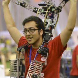 """A man from an Iranian team cheers with a humanoid robot on his shoulders after his team won against a German team during the 2015 Robocup finals in Hefei, Anhui province, July 22, 2015. The Robocup, or """"Robot Soccer World Cup"""", is an annual international robotics competitions which is held between July 17 - 23 this year in China's Hefei.   REUTERS/Stringer  CHINA OUT. NO COMMERCIAL OR EDITORIAL SALES IN CHINA"""