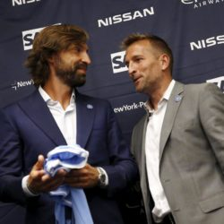 New York City FC Manager Jason Kreis (R) introduces the team's third Designed Player, Italian international Andrea Pirlo, at an event in New York, July 23, 2015. The 36-year-old former Juventus and Milan player will join the Major League Soccer (MLS) team for the rest of 2015 season.  REUTERS/Mike Segar