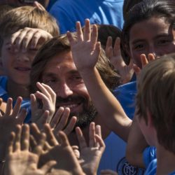 Italian international Andrea Pirlo is surrounded by youth soccer players while visiting a soccer camp after being introduced by Major League Soccer (MLS) club New York City FC as their newest player, at an event in New York, July 23, 2015. The 36-year-old former Juventus and Milan player will join New York City FC for the rest of 2015 season as their third Designated Player. REUTERS/Mike Segar