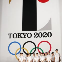 Athletes stand in front of Tokyo 2020 Olympic games emblem during an unveiling event at Tokyo Metropolitan Government Building in Tokyo July 24, 2015. The Tokyo Organising Committee of the Olympic and Paralympic Games unveiled the emblems on Friday, to mark the exactly five years before the 2020 Summer Games open in Tokyo. REUTERS/Issei Kato