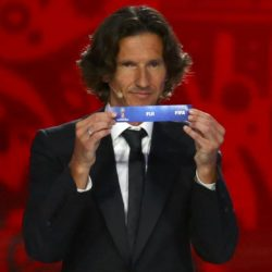 "Former Russian soccer player Alexey Smertin holds up the slip showing ""Fiji"" during the preliminary draw for the 2018 FIFA World Cup at Konstantin Palace in St. Petersburg, Russia July 25, 2015. REUTERS/Stringer"