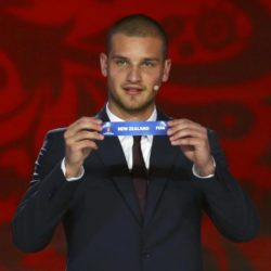 "Serbian soccer player Predrag Rajkovic holds up the slip showing ""New Zealand"" during the preliminary draw for the 2018 FIFA World Cup at Konstantin Palace in St. Petersburg, Russia July 25, 2015. REUTERS/Stringer"