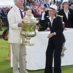 The Prince of Wales presents the Coronation Cup as he attends the Royal Salute Coronation Cup, in aid of the Polo Charities Trust, at Guards Polo Club, Windsor Great Park, Egham. PRESS ASSOCIATION Photo. Picture date: Saturday July 25, 2015. Photo credit should read: Philip Ide/Mail on Sunday/PA Wire