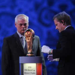 (150725) -- ST.PETERSBURG, July 25, 2015 (Xinhua) -- An official (R) puts the World Cup Trophy on display during the preliminary draw for the 2018 FIFA World Cup at Konstantin Palace in St. Petersburg, Russia July 25, 2015. (Xinhua/Dai Tianfang)