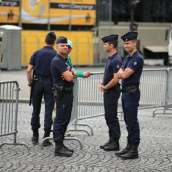 Police stand by barriers by the Champs-Elysees in Paris, France where the final stage of the Tour de France is due to finish later today. PRESS ASSOCIATION Photo. Picture date: Sunday July 26, 2015. See PA story CYCLING Tour. Photo credit should read: Mike Egerton/PA Wire