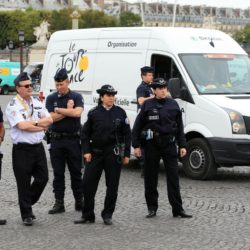 Police on the Champs-Elysees in Paris, France where the final stage of the Tour de France is due to finish later today.. PRESS ASSOCIATION Photo. Picture date: Sunday July 26, 2015. See PA story CYCLING Tour. Photo credit should read: Mike Egerton/PA Wire.