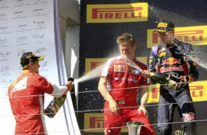 Winner Ferrari Formula One driver Sebastian Vettel of Germany (L) and second placed Red Bull Formula One driver Daniil Kvyat of Russia (R) splash champagne as they celebrate on the podium after the Hungarian F1 Grand Prix at the Hungaroring circuit, near Budapest, Hungary July 26, 2015. REUTERS/Bernadett Szabo
