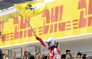 Winner Ferrari Formula One driver Sebastian Vettel of Germany waves a flag of Ferrari after the Hungarian F1 Grand Prix at the Hungaroring circuit, near Budapest, Hungary July 26, 2015. REUTERS/Bernadett Szabo