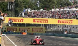 Ferrari Formula One driver Sebastian Vettel of Germany crosses the finish line to win the Hungarian F1 Grand Prix at the Hungaroring circuit, near Budapest, Hungary Sunday, July 26, 2015. REUTERS/Ronald Zak/Pool