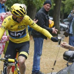 Team Sky rider Chris Froome of Britain, the race overall leader's yellow jersey, drinks a glass of champagne as he cycles during the 109.5-km (68 miles) final  21st stage of the 102nd Tour de France cycling race from Sevres to Paris Champs-Elysees, France, July 26, 2015. REUTERS/Sebastien Nogier/Pool