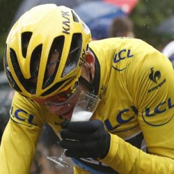 Team Sky rider Chris Froome of Britain, the race overall leader's yellow jersey, holds a glass of champagne as he cycles during the 109.5-km (68 miles) final  21st stage of the 102nd Tour de France cycling race from Sevres to Paris Champs-Elysees, France, July 26, 2015. REUTERS/Sebastien Nogier/Pool  TPX IMAGES OF THE DAY