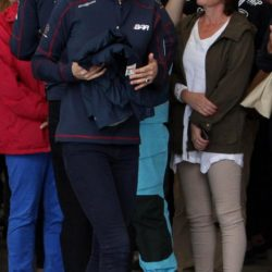 The Duchess of Cambridge carries garments handed to her as she meets staff and guests at BAR (Ben Ainslie Racing) headquarters in Portsmouth, Hampshire, as part of a visit on the second day of the opening leg of the America's Cup World Series being staged in waters off Portsmouth. PRESS ASSOCIATION Photo. Picture date: Sunday July 26, 2015. The Duchess, who is a keen sailor, joined Sir Ben in June last year when he formally launched Britain's bid to win the America's Cup for the first time. She is a committed supporter of the sailor's team BAR (Ben Ainslie Racing) and is also royal patron of the 1851 Trust, which works to inspire the next generation through sailing and the marine industry. See PA story ROYAL Kate. Photo credit should read: Steve Parsons/PA Wire