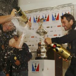 Ben Ainslie (right), skipper of Britain's Land Rover backed BAR (Ben Ainslie Racing)  team, sprays champagne on rival skipper Jimmy Spithill of Oracle Team USA as he celebrates winning the British leg of the America's Cup World Series being staged in waters off Portsmouth. PRESS ASSOCIATION Photo. Picture date: Sunday July 26, 2015. See PA story ROYAL Kate. Photo credit should read: Luke MacGregor/PA Wire