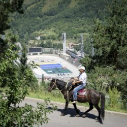 A man rides a horse near the Medeu skating oval in Almaty, Kazakhstan, July 26, 2015. Kazakhstan is aspiring to host the 2022 Winter Olympics but many in the Central Asian nation view the bid as yet another vanity project of long-ruling President Nursultan Nazarbayev. Almaty, the financial capital, will go head-to-head with the Chinese metropolis Beijing on Friday when the International Olympic Committee elects the winner at its session in Malaysia. Picture taken July 26, 2015. REUTERS/Shamil Zhumatov