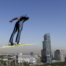 A skier soars through the air during training session at the Sunkar Ski Jumping complex in Almaty, Kazakhstan, July 15, 2015. Kazakhstan is aspiring to host the 2022 Winter Olympics but many in the Central Asian nation view the bid as yet another vanity project of long-ruling President Nursultan Nazarbayev. Almaty, the financial capital, will go head-to-head with the Chinese metropolis Beijing on Friday when the International Olympic Committee elects the winner at its session in Malaysia. Picture taken July 15, 2015. REUTERS/Shamil Zhumatov