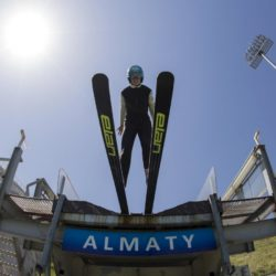 A skier jumps during training session at the Sunkar Ski Jumping complex in Almaty, Kazakhstan, July 15, 2015. Kazakhstan is aspiring to host the 2022 Winter Olympics but many in the Central Asian nation view the bid as yet another vanity project of long-ruling President Nursultan Nazarbayev. Almaty, the financial capital, will go head-to-head with the Chinese metropolis Beijing on Friday when the International Olympic Committee elects the winner at its session in Malaysia. Picture taken July 15, 2015. REUTERS/Shamil Zhumatov