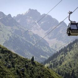 Cable cars are pictured against the backdrop of the Tien Shan mountains near the Medeu skating oval in Almaty, Kazakhstan, July 26, 2015. Kazakhstan is aspiring to host the 2022 Winter Olympics but many in the Central Asian nation view the bid as yet another vanity project of long-ruling President Nursultan Nazarbayev. Almaty, the financial capital, will go head-to-head with the Chinese metropolis Beijing on Friday when the International Olympic Committee elects the winner at its session in Malaysia. Picture taken July 26, 2015. REUTERS/Shamil Zhumatov