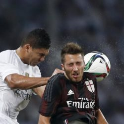 Casemiro (L) of Real Madrid fights for the ball with Bertolacci Andrea of A.C. Milan during the International Champions Cup soccer match in Shanghai, July 30, 2015. REUTERS/Aly Song