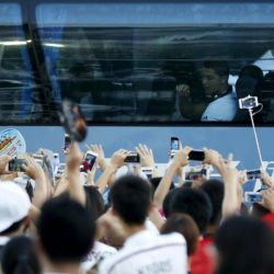 Cristiano Ronaldo greets fans as Real Madrid arrive at the stadium during the International Champions Cup soccer match against A.C. Milan in Shanghai, July 30, 2015. REUTERS/Aly Song