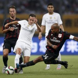 Lucas Vazquez (C) of Real Madrid fights for the ball with Bertolacci Andrea (L) and De Jong Nigel of A.C. Milan during the International Champions Cup soccer match in Shanghai, July 30, 2015. REUTERS/Aly Song