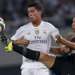 Cristiano Ronaldo (L) of Real Madrid fights for the ball with De Sciglio Mattia of A.C. Milan during the International Champions Cup soccer match in Shanghai, July 30, 2015. REUTERS/Aly Song
