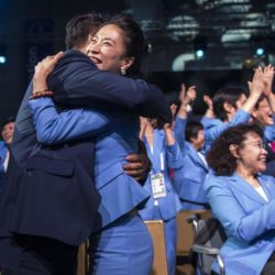 (150731) -- KUALA LUMPUR, July 31, 2015 (Xinhua) -- Shen Xue (front R), Zhao Hongbo, former Chinese Winter Olympic champions and memebers of Beijing 2022 Olympic Winter Games delegation, hug and celebrate after Beijing won the bid at the 128th International Olympic Committee session in Kuala Lumpur, Malaysia, Friday, July 31, 2015. (Xinhua/Lui Siu Wai)