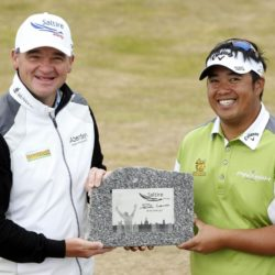 Kiradech Aphibarnrat (right) is presented with a trophy by Paul Lawrie after winning the Saltire Energy Paul Lawrie Match Play at Murcar Links Golf Club, Aberdeen. PRESS ASSOCIATION Photo. Picture date: Sunday August 2, 2015. See PA story GOLF Murcar. Photo credit should read: Danny Lawson/PA Wire. RESTRICTIONS: Editorial use only. No commercial use. No false commercial association. No video emulation. No manipulation of images.