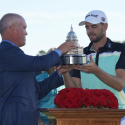 Aug 2, 2015; Gainesville, VA, USA; Troy Merritt receives the Quicken Loans National trophy from Quicken Loans CEO Bill Emerson after the final round of the Quicken Loans National golf tournament at Robert Trent Jones Golf Club. Mandatory Credit: Rafael Suanes-USA TODAY Sports