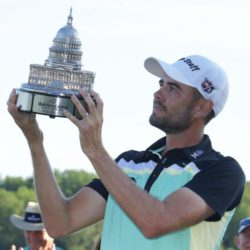 Aug 2, 2015; Gainesville, VA, USA; Troy Merritt stares at the Quicken Loans National trophy after the final round of the Quicken Loans National golf tournament at Robert Trent Jones Golf Club. Mandatory Credit: Rafael Suanes-USA TODAY Sports