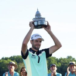 Aug 2, 2015; Gainesville, VA, USA; Troy Merritt hold up the Quicken Loans National trophy after the final round of the Quicken Loans National golf tournament at Robert Trent Jones Golf Club. Mandatory Credit: Rafael Suanes-USA TODAY Sports