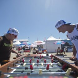 July 28, 2015 - Huntington Beach, CA, USA - Tanner Horcasitas and Cameron Gonzales play a game of foosball on the beach during the Vans US Open of Surfing in Huntington Beach, California on Tuesday, July 28, 2015. ..///ADDITIONAL INFORMATION :7/28/15  0729.features.mm - MATT MASIN, STAFF Matt Masin (Credit Image:  Matt Masin/The Orange County Register via ZUMA Wire) Lapresse Only italyU.S. Open of Surfing 2015 a Huntington Beach