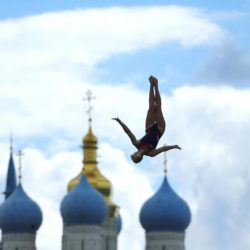 Rachelle Simpson of the U.S. dives during the women's 20m high dive competition at the Aquatics World Championships in Kazan, Russia, August 4, 2015.  Pictured in the background are Kul Sharif Mosque (L) and Annunciation Cathedral. REUTERS/Hannibal Hanschke