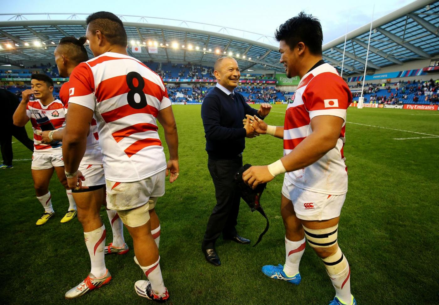 Japan's Coach Eddie Jones congratulates his team following victory over South Africa during the Rugby World Cup match at the Brighton Community Stadium, Brighton. PRESS ASSOCIATION Photo. Picture date: Saturday September 19, 2015. See PA story RUGBYU South Africa. Photo credit should read: Gareth Fuller/PA Wire. RESTRICTIONS: Editorial use only. Strictly no commercial use or association without RWCL permission. Still image use only. Use implies acceptance of Section 6 of RWC 2015 T&Cs at: http://bit.ly/1MPElTL Call +44 (0)1158 447447 for further info.