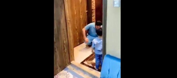 medico abbraccio figlio